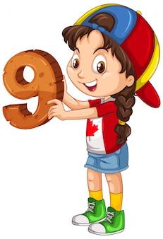 Chica canadiense con gorra sosteniendo matemáticas número nueve