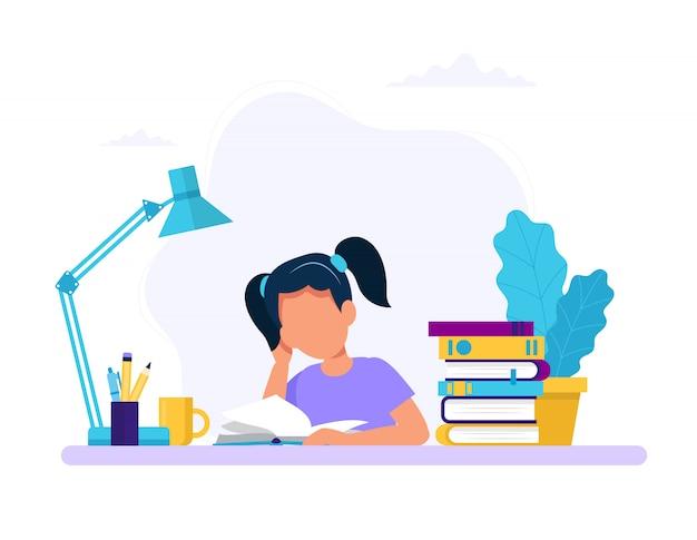 Chica estudiando con un libro.