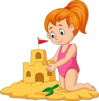 Chica feliz de dibujos animados haciendo el castillo de arena