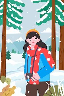 Una chica fotógrafa disfrutando de una hermosa escena de nieve en invierno