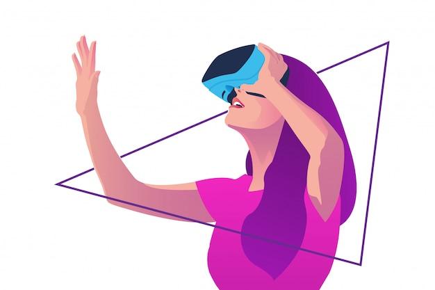 Chica con gafas de realidad virtual mientras levanta la mano derecha.