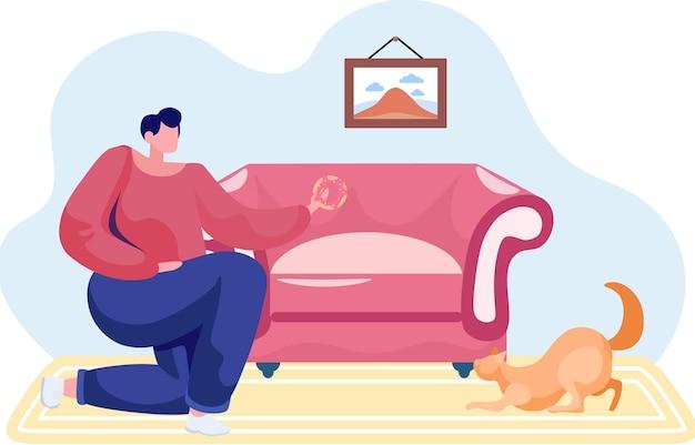 Chica con gato jengibre está descansando en casa. mujer alimentando a su gatito con donut.