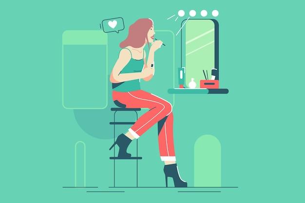 Chica guapa se maquilla