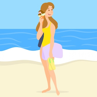 Chica con helado en la playa