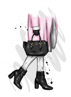 Chica en hermosos zapatos con tacones, un abrigo y con un elegante bolso.