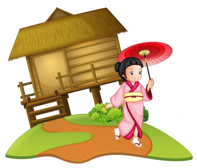 Una chica japonesa en cabaña de madera.