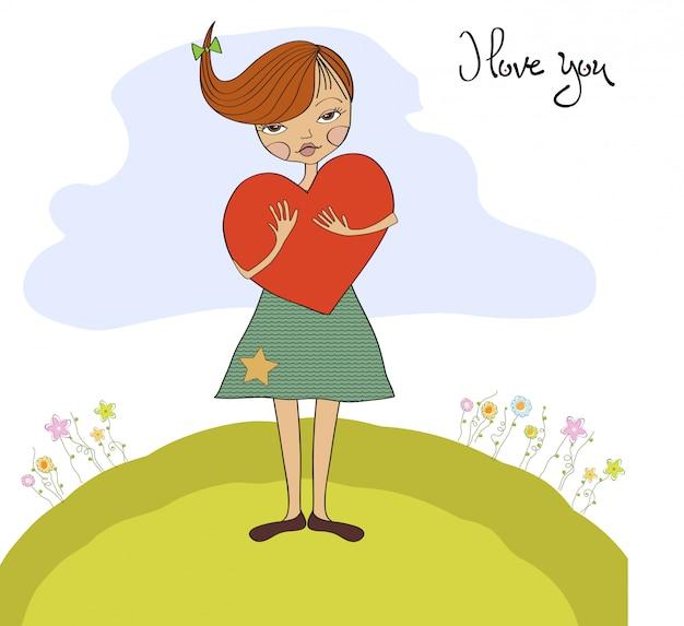 Chica joven romántica con gran corazón