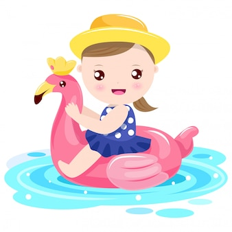 Chica jugando con anillo de natación flamenco