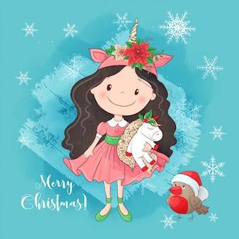 Chica linda de la historieta con un unicornio. tarjeta de felicitación para año nuevo y navidad.