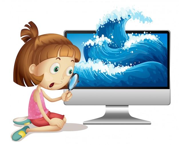 Chica mira a través de una lupa junto a la computadora