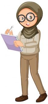 Chica musulmana escribiendo notas sobre blanco