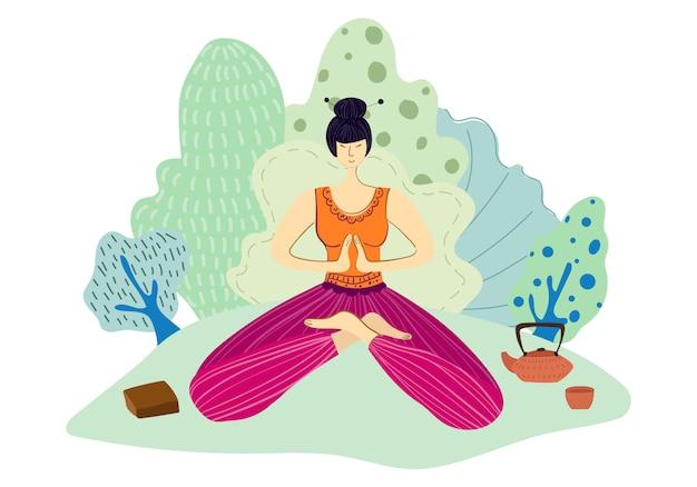 Chica o mujer en el parque haciendo yoga