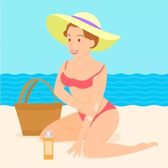 Chica poniéndose crema solar en la playa