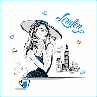 La chica del sombrero tomando café.
