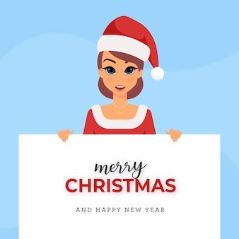 Chica con tarjeta de navidad de traje de santa claus sobre fondo azul.