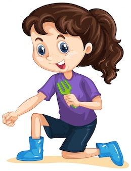 Chica con tenedor de jardinería en aislado