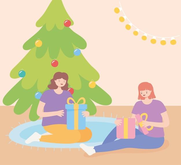 Chicas en la fiesta de navidad sentados abriendo cajas de regalo ilustración vectorial