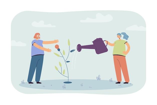 Chicas regando el árbol de la pequeña idea