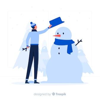 Chico azul con muñeco de nieve estilo plano