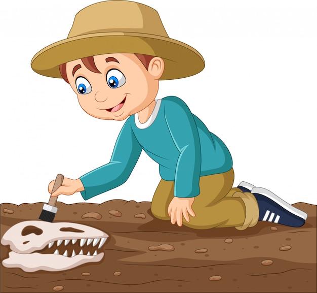 Chico de dibujos animados cepillando un fósil de dinosaurio