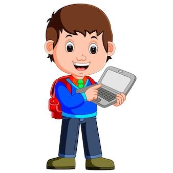 Chico de dibujos animados con tableta y portátil