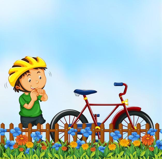 Chico con escena de la naturaleza en bicicleta