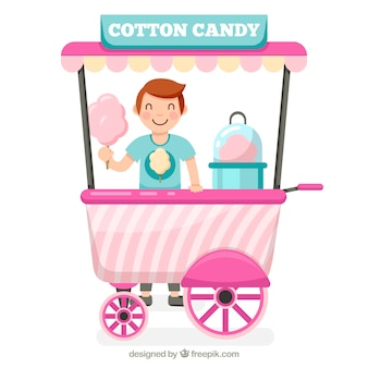 Chico feliz con carro de algodón de azúcar