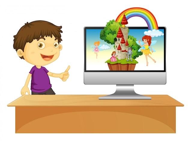 Chico junto a la pantalla del cuento de hadas de la computadora
