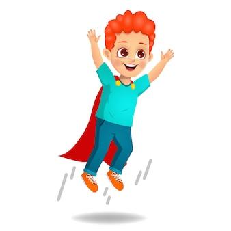 Chico lindo con capa de superhéroe almorzando en vuelo