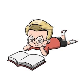 Chico lindo leyendo el libro de dibujos animados