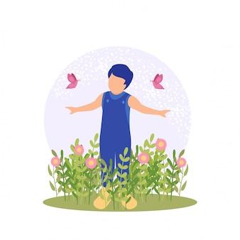 Chico lindo de la primavera jugando flor y mariposa
