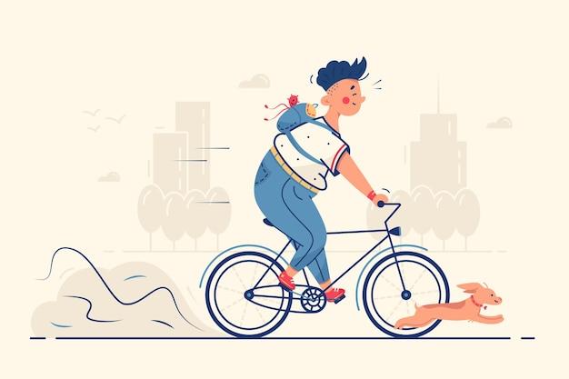 Chico montando bicicleta con perro