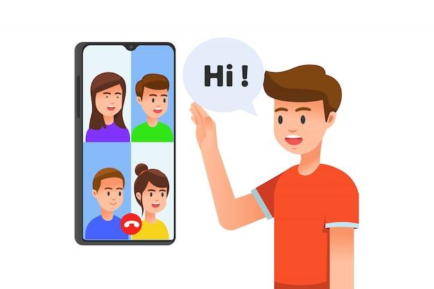 Chico que tiene video chat grupal con sus amigos