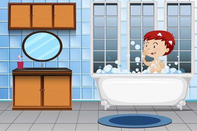 Un chico tomando baño