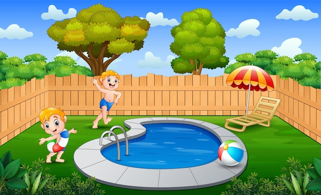 Chicos felices divirtiéndose en la piscina