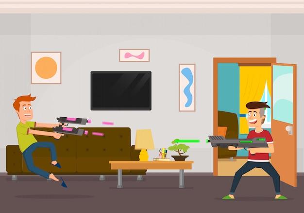 Chicos guapos juegan guerra de juguetes en su sala de juegos
