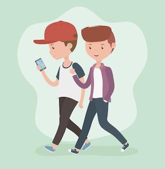 Chicos jóvenes caminando con teléfonos inteligentes