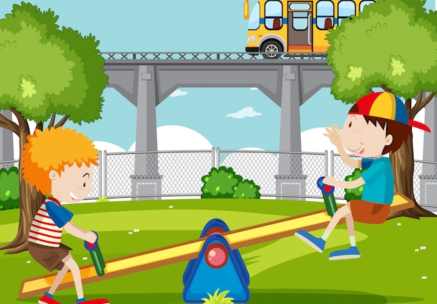 Chicos jugando balancín en el parque