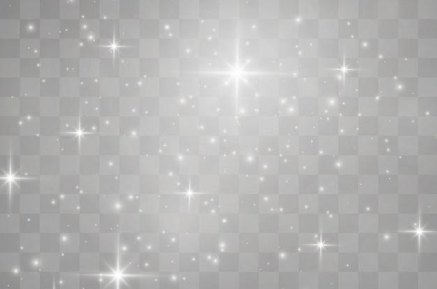 Las chispas blancas brillan con un efecto de luz especial. resumen de navidad. partículas de polvo mágico espumoso