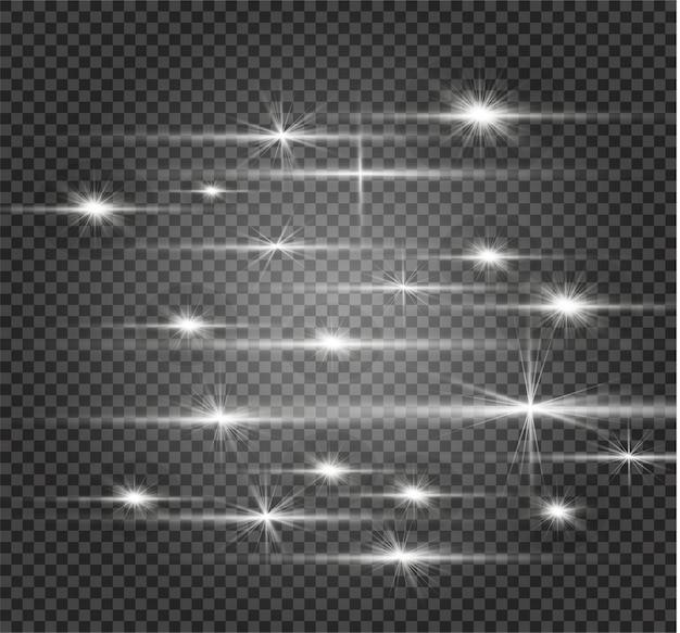 Las chispas blancas y las estrellas doradas brillan con un efecto de luz especial. destellos sobre fondo transparente. resumen de navidad