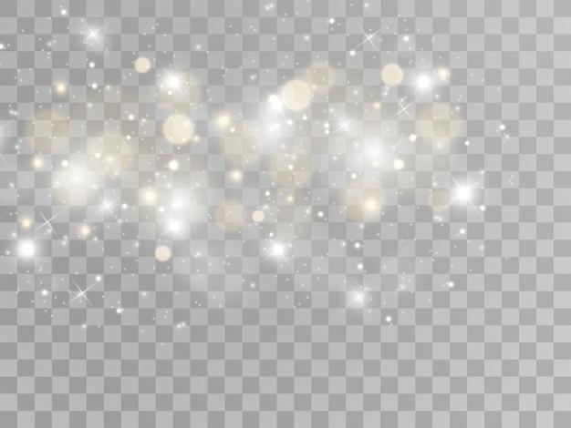 Chispas blancas y estrellas doradas brillan con efecto de luz especial. partículas de polvo mágico espumoso