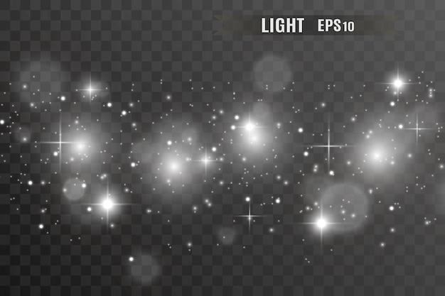Las chispas blancas y las estrellas doradas brillan con efecto de luz especial.