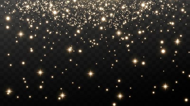 Las chispas doradas y las estrellas doradas brillan con un efecto de luz especial.