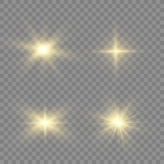 Las chispas de polvo y las estrellas doradas brillan con una luz especial. brilla sobre un fondo transparente. efecto de luz navideña. interior de partículas de polvo mágico espumoso