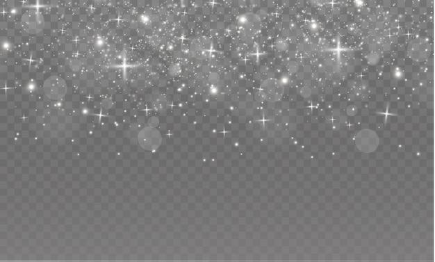 Las chispas de polvo y las estrellas doradas brillan con una luz especial. brilla sobre un fondo transparente. efecto de luz navideña. partículas de polvo mágico espumoso.