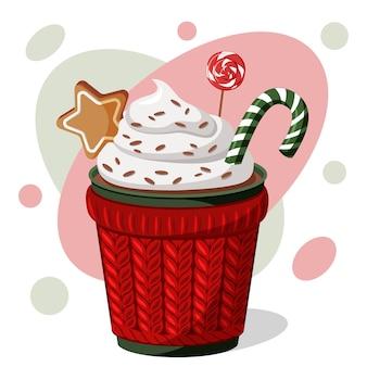 Chocolate caliente navideño con nata, bastón de caramelo, piruleta y galleta.