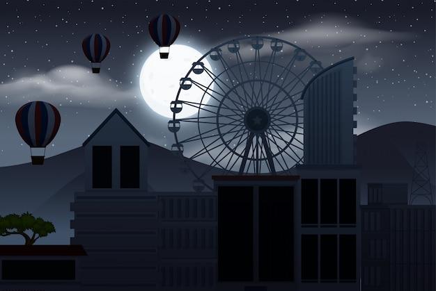 Cielo oscuro sobre la silueta de la ciudad con globos aerostáticos