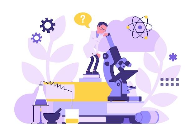 Científico masculino que trabaja con microscopio