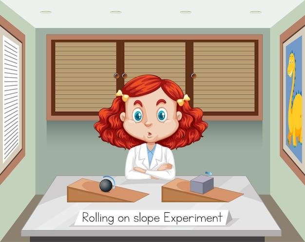 Científicos jóvenes con el experimento de rodar en pendiente