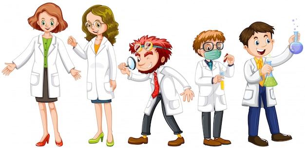 Científicos masculinos y femeninos en bata blanca